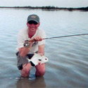 small permit with fly rod