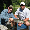 guide and angler with fly caught chinook salmon